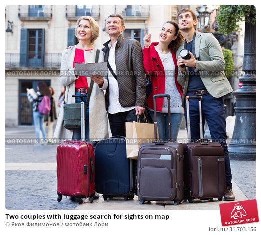 Купить «Two couples with luggage search for sights on map», фото № 31703156, снято 14 ноября 2019 г. (c) Яков Филимонов / Фотобанк Лори