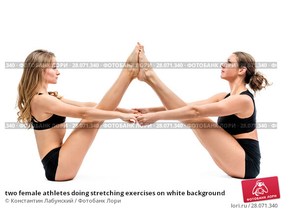 Купить «two female athletes doing stretching exercises on white background», фото № 28071340, снято 7 октября 2017 г. (c) Константин Лабунский / Фотобанк Лори
