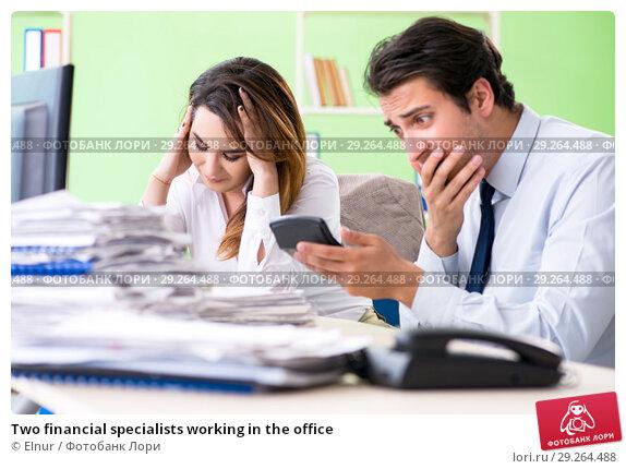 Купить «Two financial specialists working in the office», фото № 29264488, снято 11 июня 2018 г. (c) Elnur / Фотобанк Лори