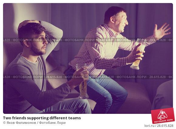 Купить «Two friends supporting different teams», фото № 28615828, снято 7 февраля 2018 г. (c) Яков Филимонов / Фотобанк Лори