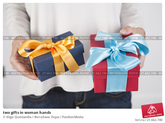 Купить «two gifts in woman hands», фото № 21662740, снято 22 февраля 2019 г. (c) PantherMedia / Фотобанк Лори