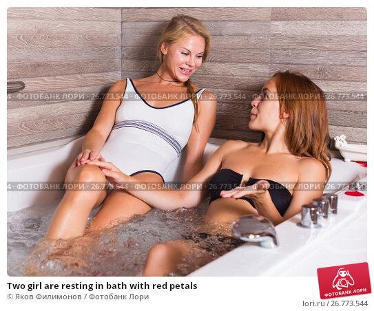 Купить «Two girl are resting in bath with red petals», фото № 26773544, снято 18 июля 2017 г. (c) Яков Филимонов / Фотобанк Лори