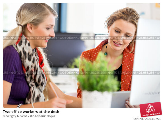 Two office workers at the desk, фото № 26036256, снято 14 декабря 2014 г. (c) Sergey Nivens / Фотобанк Лори
