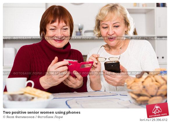 Купить «Two positive senior women using phones», фото № 29396612, снято 22 ноября 2017 г. (c) Яков Филимонов / Фотобанк Лори