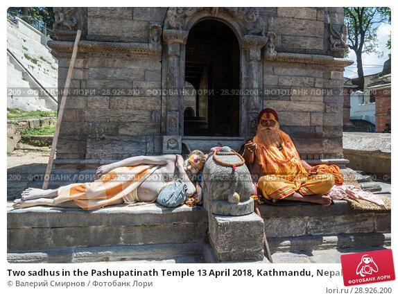 Купить «Two sadhus in the Pashupatinath Temple 13 April 2018, Kathmandu, Nepal», фото № 28926200, снято 13 апреля 2018 г. (c) Валерий Смирнов / Фотобанк Лори