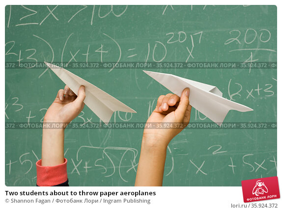 Two students about to throw paper aeroplanes. Стоковое фото, фотограф Shannon Fagan / Ingram Publishing / Фотобанк Лори