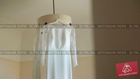 Two wedding dresses in room, видеоролик № 25795336, снято 16 марта 2016 г. (c) Алексей Макаров / Фотобанк Лори