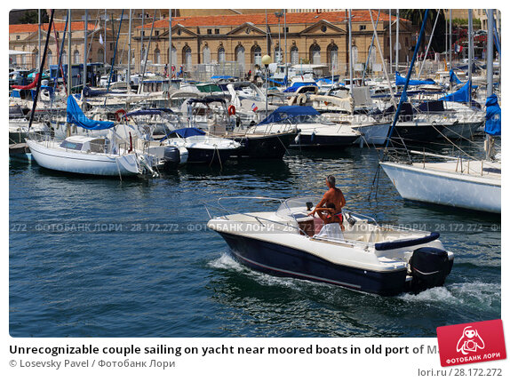 Купить «Unrecognizable couple sailing on yacht near moored boats in old port of Marseille, France at summer day», фото № 28172272, снято 31 июля 2016 г. (c) Losevsky Pavel / Фотобанк Лори