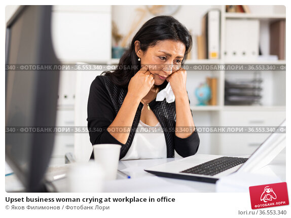 Upset business woman crying at workplace in office. Стоковое фото, фотограф Яков Филимонов / Фотобанк Лори