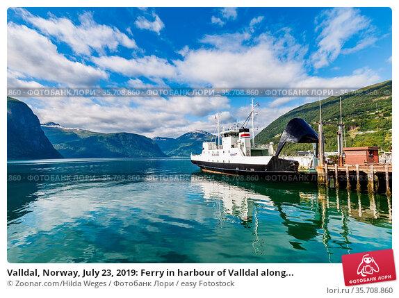 Valldal, Norway, July 23, 2019: Ferry in harbour of Valldal along... Стоковое фото, фотограф Zoonar.com/Hilda Weges / easy Fotostock / Фотобанк Лори