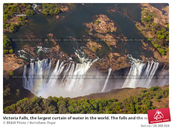 Купить «Victoria Falls, the largest curtain of water in the world. The falls and the surrounding area is the National Parks and World Heritage Site, Zambia and Zimbabwe.», фото № 28308924, снято 18 февраля 2019 г. (c) BE&W Photo / Фотобанк Лори