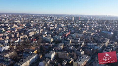 View from drone of contemporary townscape of Lodz, third largest city in Poland and former industrial centre on sunny spring day. Стоковое видео, видеограф Яков Филимонов / Фотобанк Лори