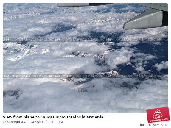 Купить «View from plane to Caucasus Mountains in Armenia», фото № 28307164, снято 4 апреля 2018 г. (c) Володина Ольга / Фотобанк Лори