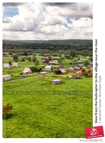 Купить «View from the helicopter to the village near the river», фото № 28426372, снято 18 июня 2017 г. (c) Евгений Ткачёв / Фотобанк Лори