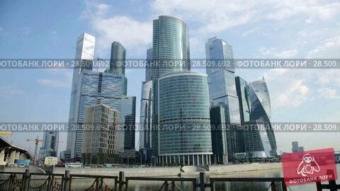 Купить «View on moscow international business center on bright summer day», видеоролик № 28509692, снято 22 августа 2016 г. (c) Яков Филимонов / Фотобанк Лори