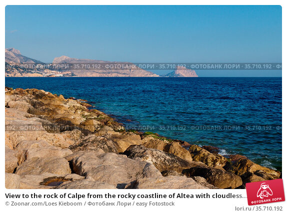 View to the rock of Calpe from the rocky coastline of Altea with cloudless... Стоковое фото, фотограф Zoonar.com/Loes Kieboom / easy Fotostock / Фотобанк Лори