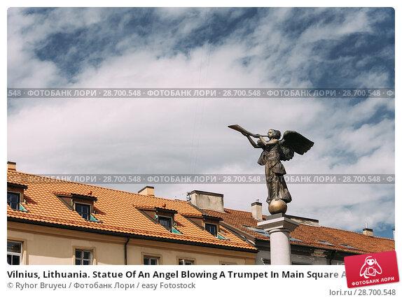 Купить «Vilnius, Lithuania. Statue Of An Angel Blowing A Trumpet In Main Square Against A Sunny Blue Sky In Uzupis District. Uzupio Republic Or Uzupis Is A Cultural Artistic District, Popular Tourist Place.», фото № 28700548, снято 5 июля 2016 г. (c) easy Fotostock / Фотобанк Лори