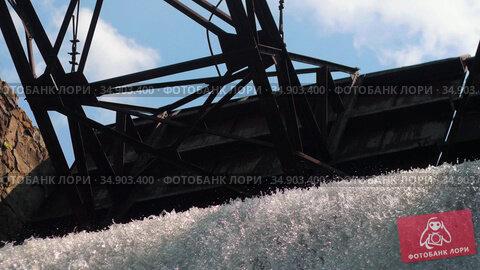 Water dam - heavy water stream falls down under a metal construction. Стоковое видео, видеограф Константин Шишкин / Фотобанк Лори