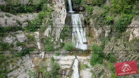 Купить «waterfall on Sant Miquel del Fai in the Spain.», видеоролик № 30174252, снято 23 июня 2018 г. (c) Яков Филимонов / Фотобанк Лори