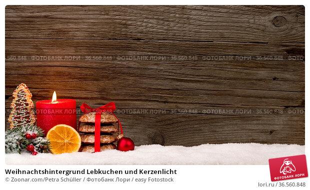 Weihnachtshintergrund Lebkuchen und Kerzenlicht. Стоковое фото, фотограф Zoonar.com/Petra Schüller / easy Fotostock / Фотобанк Лори