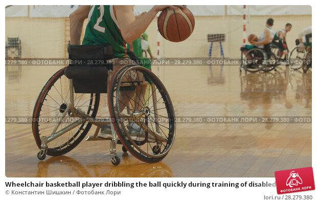 Купить «Wheelchair basketball player dribbling the ball quickly during training of disabled sportsmen», фото № 28279380, снято 11 декабря 2018 г. (c) Константин Шишкин / Фотобанк Лори