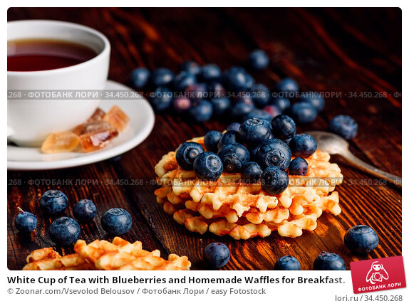 White Cup of Tea with Blueberries and Homemade Waffles for Breakfast. Стоковое фото, фотограф Zoonar.com/Vsevolod Belousov / easy Fotostock / Фотобанк Лори