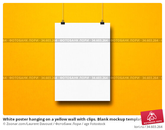 White poster hanging on a yellow wall with clips. Blank mockup template. Стоковое фото, фотограф Zoonar.com/Laurent Davoust / age Fotostock / Фотобанк Лори