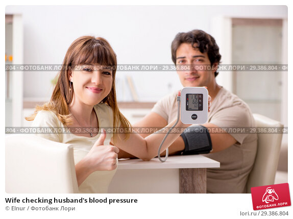 Купить «Wife checking husband's blood pressure», фото № 29386804, снято 27 июля 2018 г. (c) Elnur / Фотобанк Лори