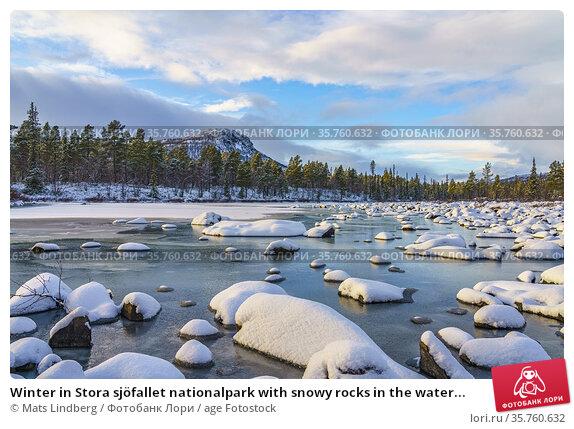 Winter in Stora sjöfallet nationalpark with snowy rocks in the water... Стоковое фото, фотограф Mats Lindberg / age Fotostock / Фотобанк Лори