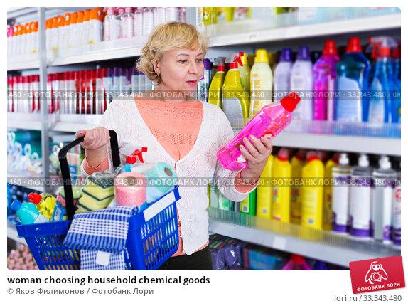 Купить «woman choosing household chemical goods», фото № 33343480, снято 20 декабря 2017 г. (c) Яков Филимонов / Фотобанк Лори