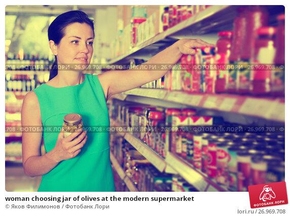 Купить «woman choosing jar of olives at the modern supermarket», фото № 26969708, снято 6 июня 2017 г. (c) Яков Филимонов / Фотобанк Лори