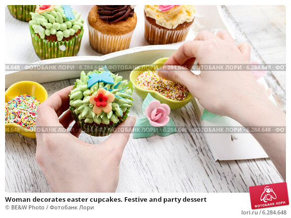 decorating woman decorating cupcakes - Woman Decorating Cupcakes