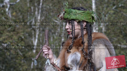 Woman in traditional clothing of aboriginal people talking about herself during contest for women. Itelmens national ritual festival thanksgiving nature Alhalalalay. Kamchatka Peninsula (2019 год). Редакционное видео, видеограф А. А. Пирагис / Фотобанк Лори