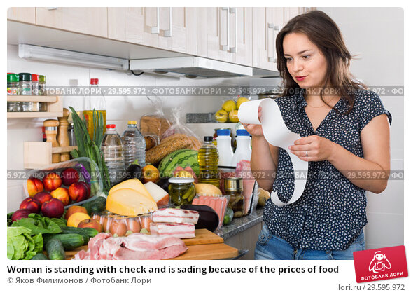 Купить «Woman is standing with check and is sading because of the prices of food», фото № 29595972, снято 5 сентября 2017 г. (c) Яков Филимонов / Фотобанк Лори