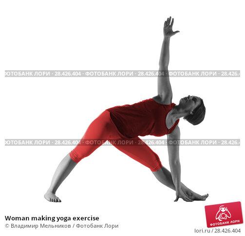Купить «Woman making yoga exercise», фото № 28426404, снято 30 апреля 2018 г. (c) Владимир Мельников / Фотобанк Лори