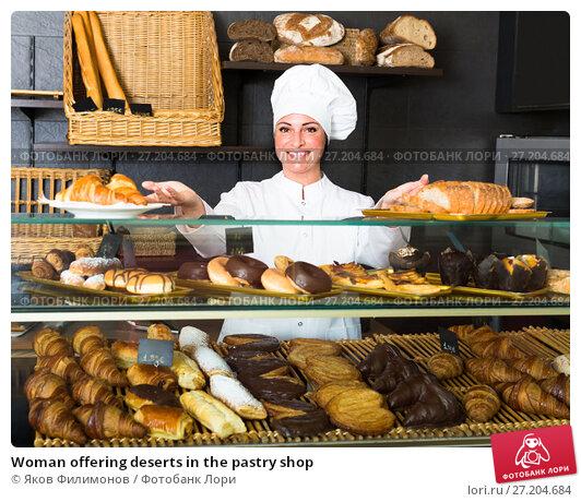 Купить «Woman offering deserts in the pastry shop», фото № 27204684, снято 15 декабря 2018 г. (c) Яков Филимонов / Фотобанк Лори