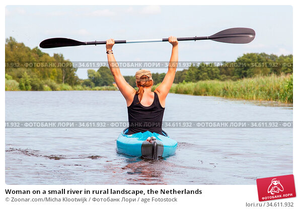 Woman on a small river in rural landscape, the Netherlands. Стоковое фото, фотограф Zoonar.com/Micha Klootwijk / age Fotostock / Фотобанк Лори