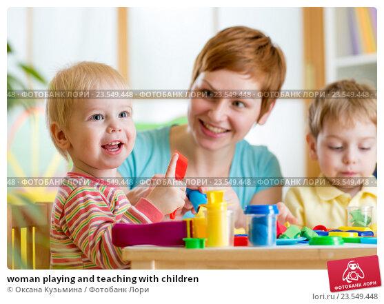 woman playing and teaching with children, фото № 23549448, снято 26 декабря 2014 г. (c) Оксана Кузьмина / Фотобанк Лори