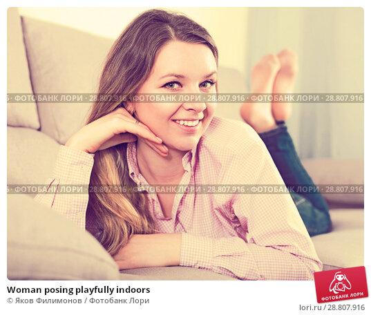 Купить «Woman posing playfully indoors», фото № 28807916, снято 13 марта 2017 г. (c) Яков Филимонов / Фотобанк Лори