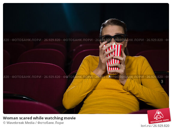 Купить «Woman scared while watching movie», фото № 26929820, снято 20 апреля 2017 г. (c) Wavebreak Media / Фотобанк Лори