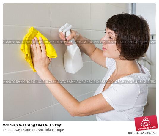 Купить «Woman washing tiles with rag», фото № 32210752, снято 22 ноября 2018 г. (c) Яков Филимонов / Фотобанк Лори