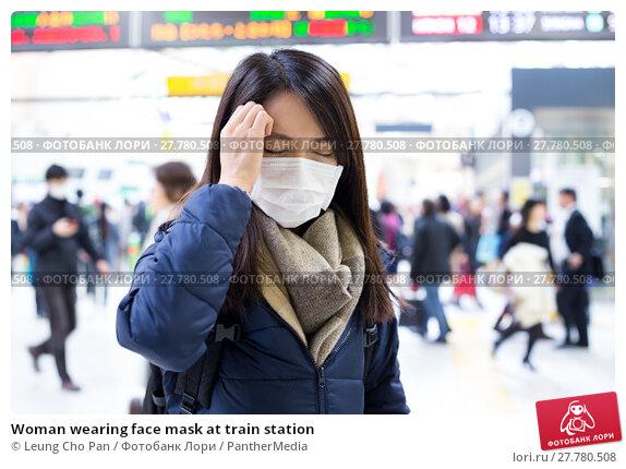 Купить «Woman wearing face mask at train station», фото № 27780508, снято 24 февраля 2020 г. (c) PantherMedia / Фотобанк Лори