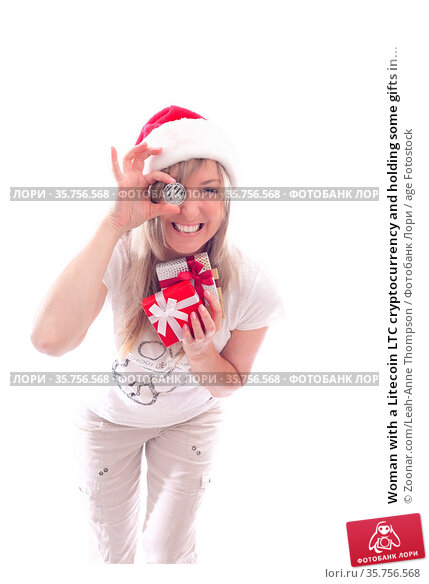 Woman with a Litecoin LTC cryptocurrency and holding some gifts in... Стоковое фото, фотограф Zoonar.com/Leah-Anne Thompson / age Fotostock / Фотобанк Лори