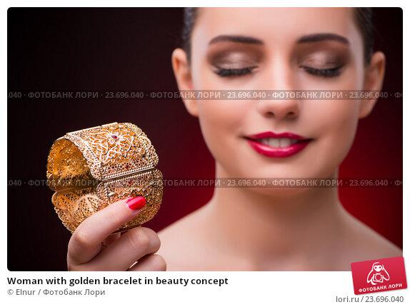 Купить «Woman with golden bracelet in beauty concept», фото № 23696040, снято 14 июля 2016 г. (c) Elnur / Фотобанк Лори