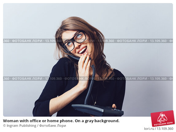 Купить «Woman with office or home phone. On a gray background.», фото № 13109360, снято 23 апреля 2015 г. (c) Ingram Publishing / Фотобанк Лори