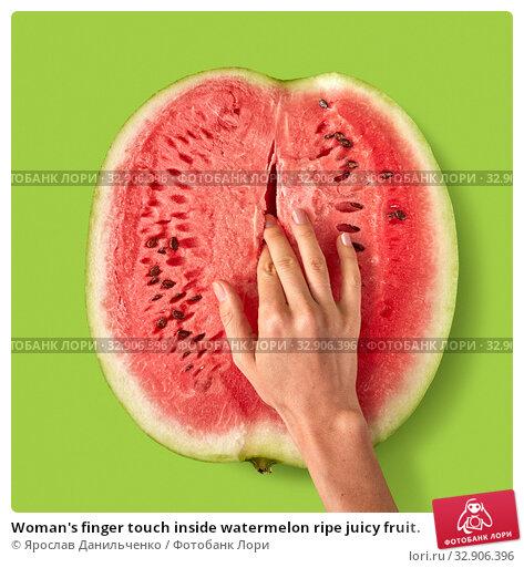 Woman's finger touch inside watermelon ripe juicy fruit. Стоковое фото, фотограф Ярослав Данильченко / Фотобанк Лори