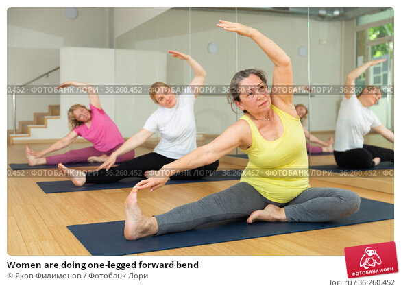 Women are doing one-legged forward bend. Стоковое фото, фотограф Яков Филимонов / Фотобанк Лори