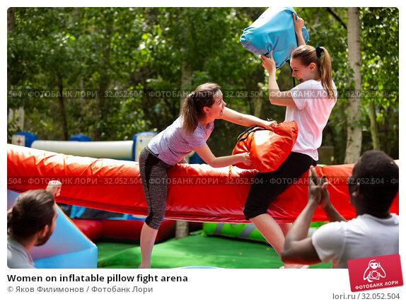 Women on inflatable pillow fight arena. Стоковое фото, фотограф Яков Филимонов / Фотобанк Лори