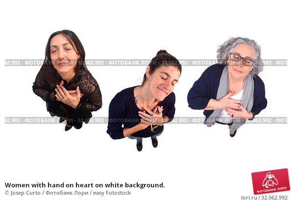 Women with hand on heart on white background. Стоковое фото, фотограф Josep Curto / easy Fotostock / Фотобанк Лори