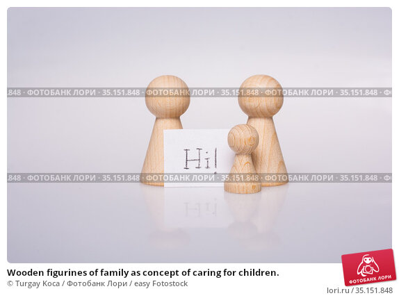 Wooden figurines of family as concept of caring for children. Стоковое фото, фотограф Turgay Koca / easy Fotostock / Фотобанк Лори